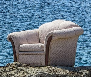 Armchair on a rock in front of the ocean